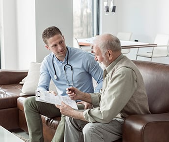 retired man talking with his doctor